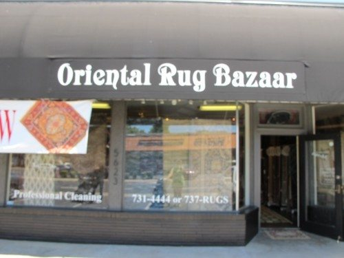 Street view of Morry's. Five window displaying tufted and machine made rugs, showing that today, Morry's carries more than just Oriental rugs.