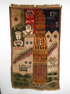 Rug with the Minaret of Jam and Portraits (Ahmad Shah Massoud and Ismail Khan) Knotted wool, Western Afghanistan Acquired in Kabul 2006hanistan<br /> Acquired in Kabul 2006<br />