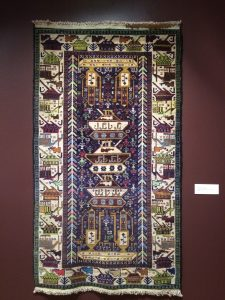 War Rug with Tanks, 1980s Knotted wool, Southern Afghanistan Acquired in Kabul , 1990s